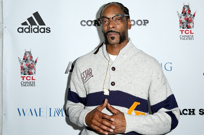 42 people injured as barrier collapses during Snoop Dogg concert