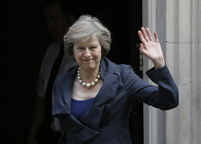 Cameron out, May in on dramatic day in British politics