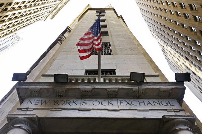 US stocks hit record highs on easing central bank outlook, oil rise
