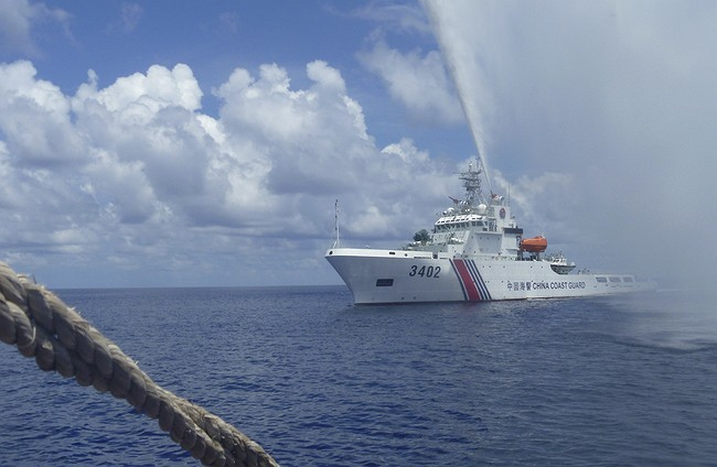 Philippines verifying if Chinese ships left disputed shoal