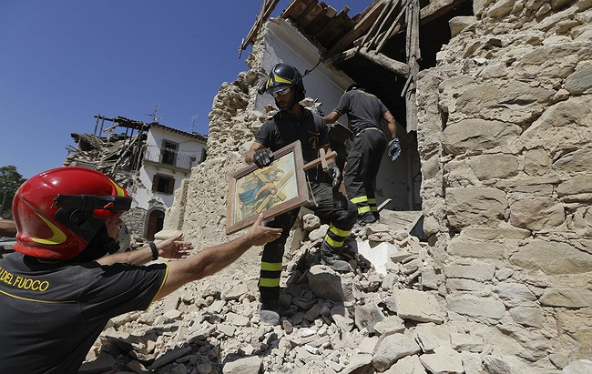 Italy lowers quake death toll back to 290