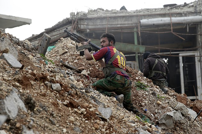 Syrian troops seize wide southern stretch of city of Aleppo