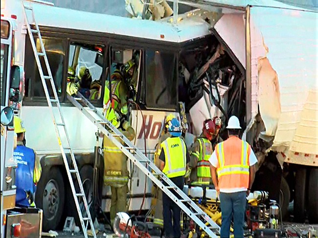 At least 3 dead after tour bus, truck crash in California