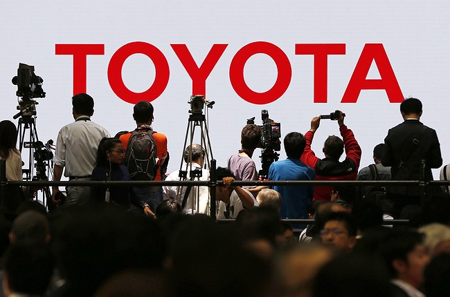 Toyota posts $5.4 billion quarterly profit, raises forecast