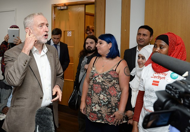 Jeremy Corbyn re-elected leader of divided UK Labour Party