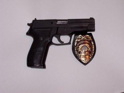 man with gun badge - photo #19