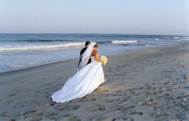On The Beach After Exchanging Vows Photo By Roger Kirby Via Free Images